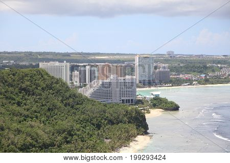 Coastal view of Guam, with hotels and commercial buildings along the coast of Tamuning, Guam