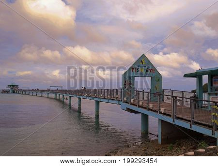 GUAM, USA--Long wooden bridge to the Fish Eye Marine Park, an underwater observatory which is one of the top attractions on Guam in a photo taken in December 2016.