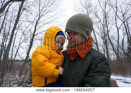 JOLIET, ILLINOIS / UNITED STATES - JANUARY 3, 2016: A father and his child pose for a photograph in the Rock Run Preserve.