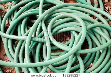 close up green rubber band on cement floor