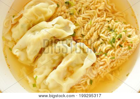 soft boiled instant noodles dressing pork dumpling on bowl