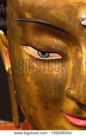 lhasa august 2011:  tibetan gilded buddha head eye close up  lhasa means