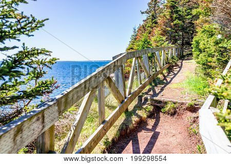 Trail Hiking In Bonaventure Island By Perce, Quebec In Gaspe, Gaspesie Region With Wooden Fence