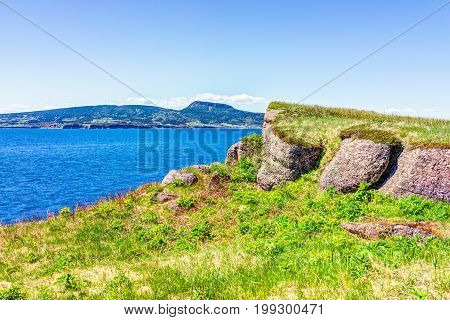 Trail Hiking In Bonaventure Island By Perce, Quebec In Gaspe, Gaspesie Region With Edge Of Cliff And