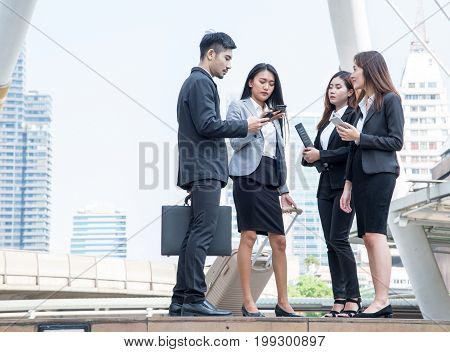 Group of business people talking with mobile phone or tablet Meeting Communication Discussion Working Concept