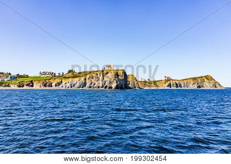 Panorama Cityscape Of Perce In Gaspe Peninsula, Quebec, Gaspesie Region With Cliffs And Blue Ocean
