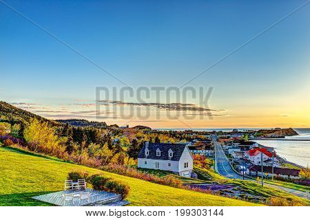 Hotel Chairs On Hill During Sunrise In Perce, Gaspe Peninsula, Quebec, Canada, Gaspesie Region With