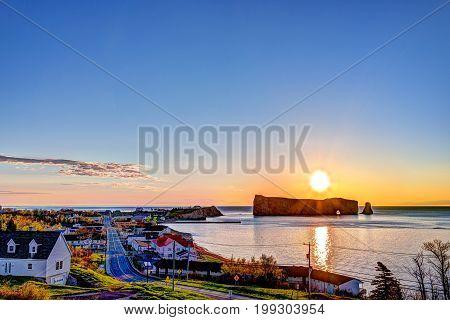 Famous Rocher Perce Rock In Gaspe Peninsula, Quebec, Canada, Gaspesie Region At Red Sunrise And Sun