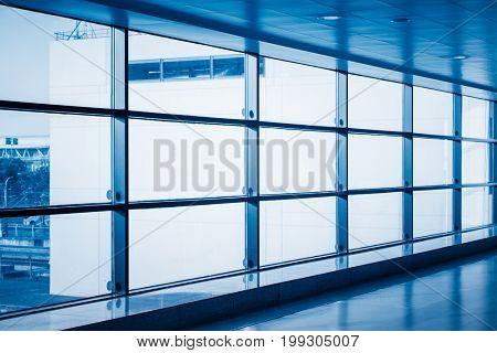 empty corridor at airport terminal,shanghai,blue toned.