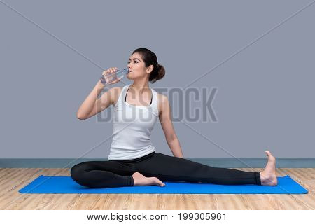 Young Asian Woman Drink Water After Finish Workout At Healthy Sport Gym.photo Concept For Yoga Sport
