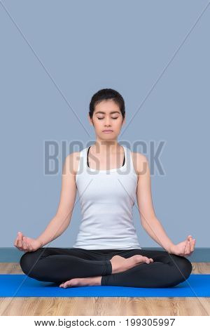 Asian Woman Keep Calm And Meditates While Practicing Yoga To Explore The Inner Peace. Yoga And Medit
