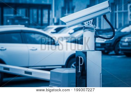 survillance camera at parking lot,blue toned,tianjin,china.
