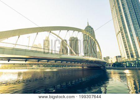 low angle view of Daguqiao bridge on haihe river and city skyline,Tianjin,China.