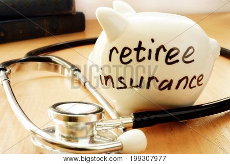 Piggy bank with words on a side retiree insurance.