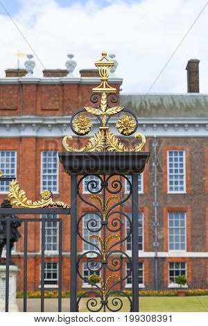LONDON UNITED KINGDOM - JUNE 23 2017: Kensington Palace in Kensington Gardens decorative gate. It has been a residence of the British Royal Family since the 17th century and Queen Victoria's birthplace