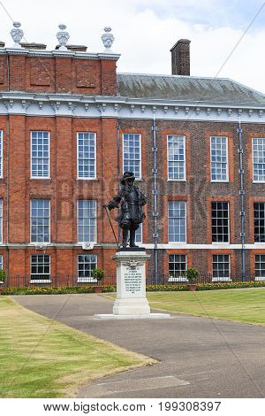 LONDON UNITED KINGDOM - JUNE 23 2017: Statue of William III in front of Kensington Palace in Kensington Gardens. It has been a residence of the British Royal Family since the 17th century and Queen Victoria's birthplace