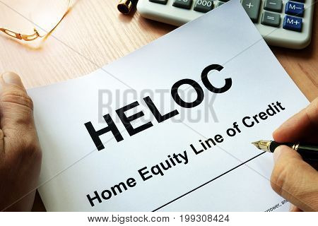 Document HELOC Home equity line of credit on a table.