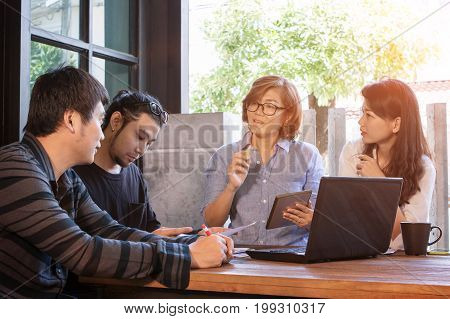 team of freelance meeting for working solution in home office