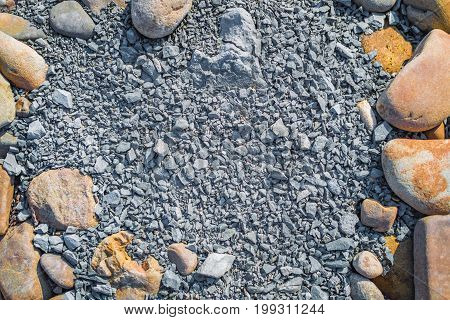 Stone texture. Natural background of small gravel and rock frame