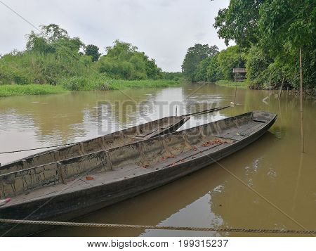 The background image of old boat parked on unused river in Thailand.