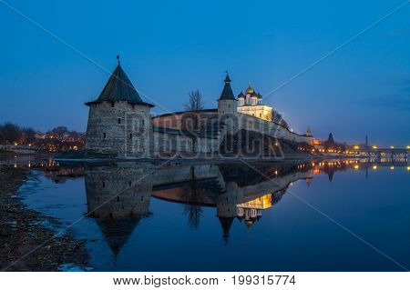 Pskov Kremlin at the confluence of two rivers, the Great and Pskov at night. Russia.