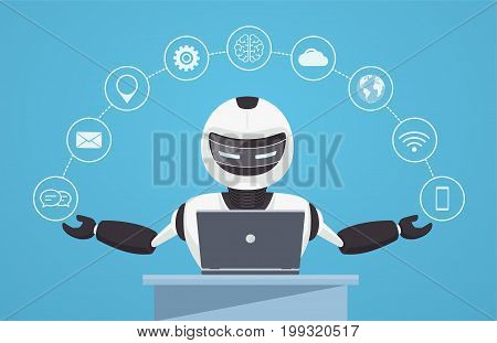 Chat bot robot virtual assistance. Robot sits behind a laptop with help icons around it. Artificial intelligence concept online.