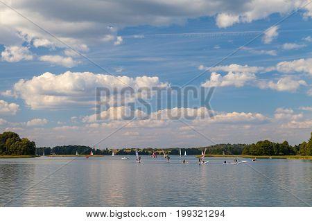 TRAKAI, LITHUANIA - 22 AUG 2015: Windsurfers training on the lake in sunny day