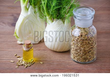 fennel essential oil, bulb and seeds, selective focus