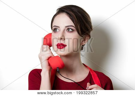 Young Housewife With Red Handset