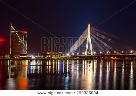 RIGA, LATVIA - 08 MAY 2016 View of business buildings of Riga in Latvia with the river Daugava at night