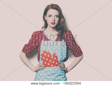 Woman In Pinafore With Potholder