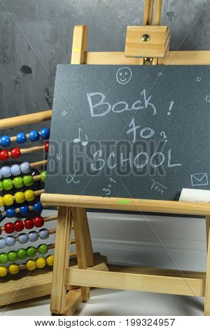 Sign ,,Back to school` on the black board/This is notice ,,Back to school` on the black board.