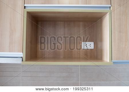 White electric plugs in wooden shelf decoration in home