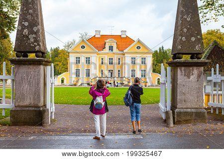 PALMSE, ESTONIA - 22 SEP 2015. Tourists shooting beautiful and rich Palmse Manor in Estonia