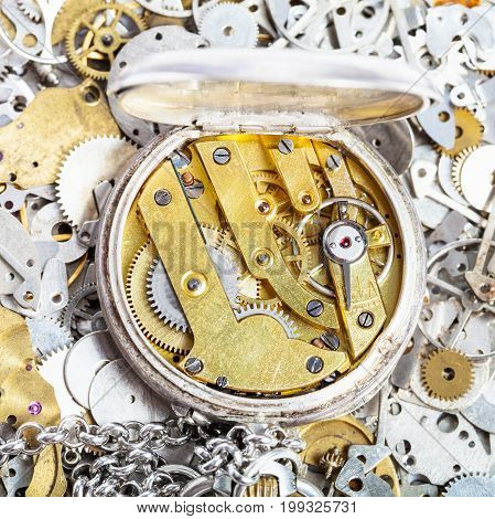 Open Retro Pocket Watch On Pile Of Spare Parts