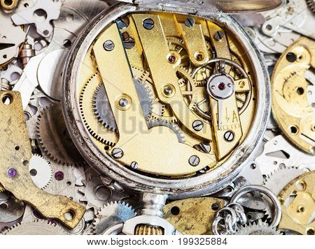 Mechanical Pocket Watch On Pile Of Spare Parts