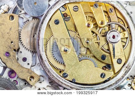 Brass Mechanical Watch On Pile Of Spare Parts