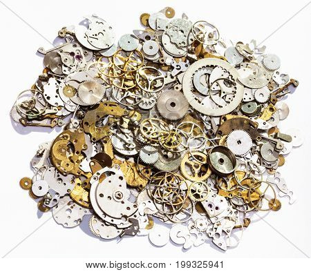 Heap Of Old Watch Spare Parts On White Background