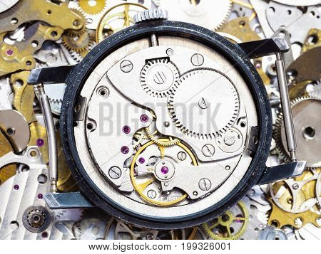 Open Mechanical Wristwatch On Pile Of Spare Parts