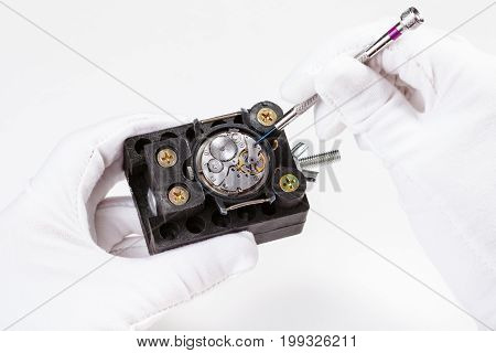 Repairing Of Mechanic Wristwatch With Screwdriver