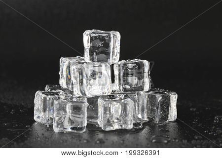 Ice Cubes Over Black Background