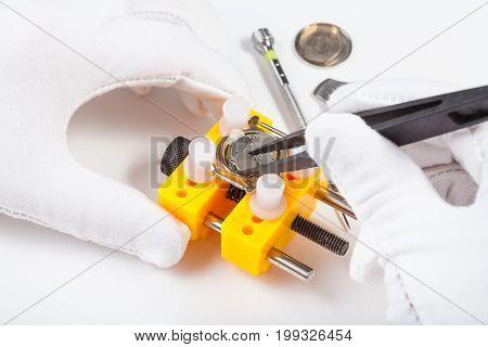 Replacing A Battery In Quartz Watch By Tweezers