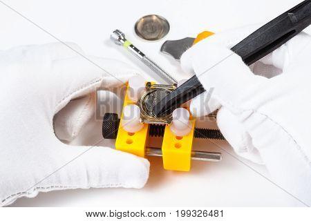 Fixing Of Battery In Quartz Wristwatch By Tweezers