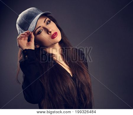 Beautiful Sexy Young Make-up Model In Blue Baseball Cap With Red Lipstick Posing On Dark Shadow Grey