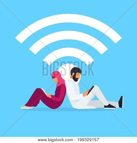 Wi-Fi concept. Young Muslim couple sit back to back and read using a tablet pc. Arab men and women in traditional clothes use laptops. Vector illustration.