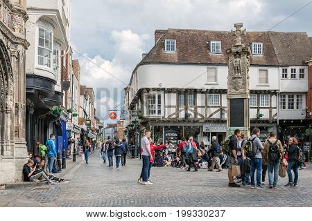 CANTERBURY ENGLAND - JUNE 07 2017: Old historic town square with people downtown medieval Canterbury city Kent England