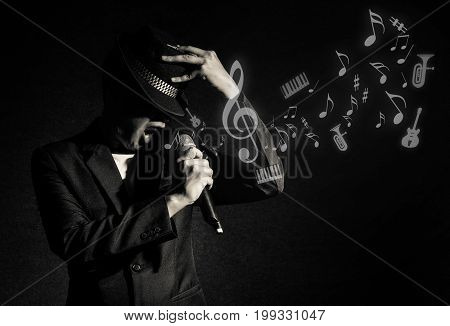 Songer hand holding the microphone and singing with music notes or melody on black background musical concept,3D illustration