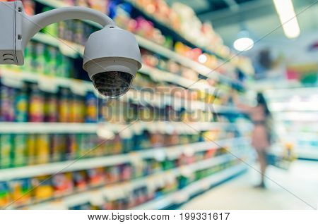Security camera monitoring on the Abstract blurred photo of store in department store bokeh background business shopping base on security concept