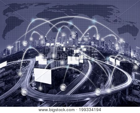 Network connection line between building over the top view of cityscape with the Elevated highway and world map background which dicut each elements cool tone color network and connection concept,3D illustration