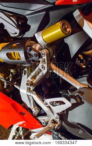 fragment of the suspension of a modern motorbike. Aluminium parts of frame.